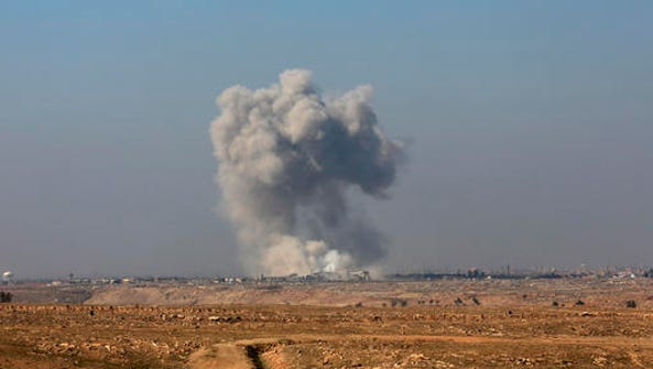 Smoke rises from the western side of Mosul following