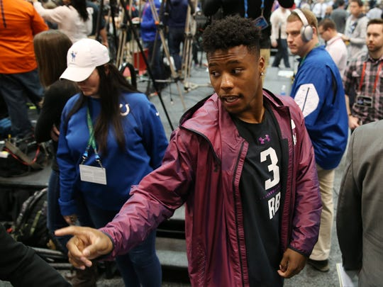 Mar 1, 2018; Indianapolis, IN, USA; Penn State Nittany Lions running back Saquon Barkley is escorted from the stage after completing his media interview during the 2018 NFL Combine at the Indianapolis Convention Center. Mandatory Credit: Brian Spurlock-USA TODAY Sports