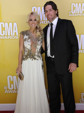 Carrie Underwood with her husband Mike Fisher in 2012.