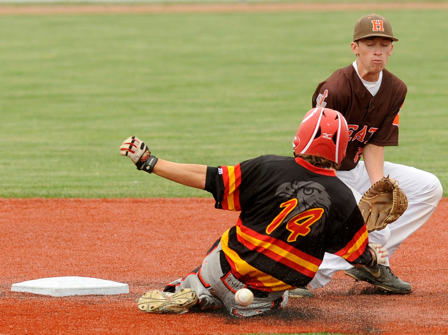 Heath's Cade Risch is unable to catch a throw at second as a Big Walnut runner slides safely Wednesday during a Division II district final at Beavers Field. The Bulldogs lost 6-0.