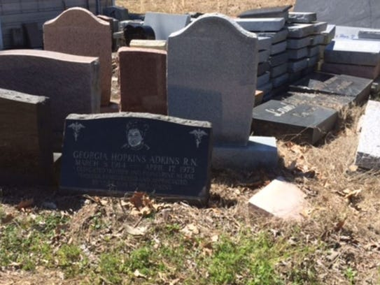Headstones piled near the offices of Galilee Memorial