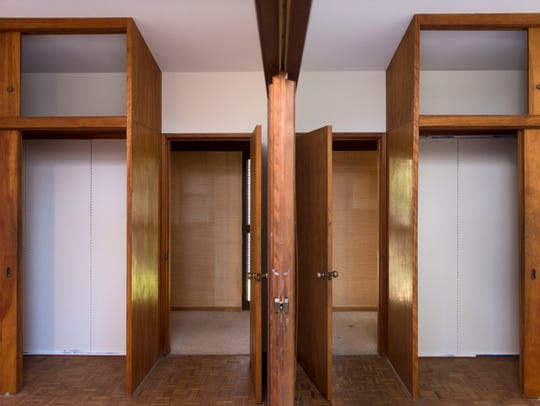 A divider splits a single bedroom at the McCarty House.