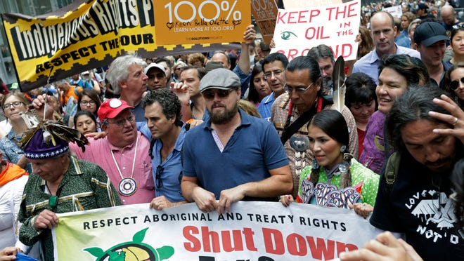 Leonardo DiCaprio, center, and Mark Ruffalo, to his left, participate in the People's Climate March in New York on Sept. 21.