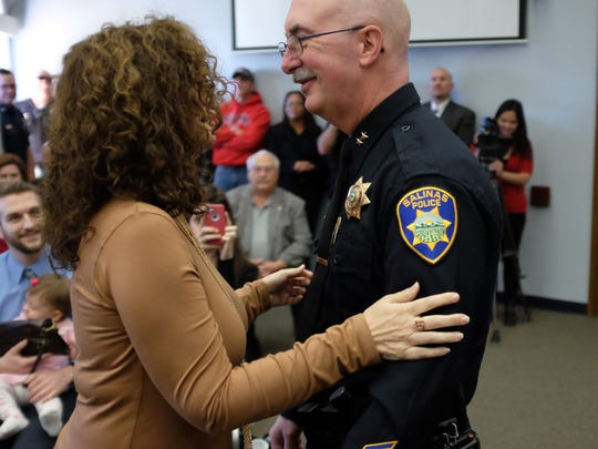 Commander Dave Shaw was promoted to the rank of Deputy Chief at Wednesday's ceremony. At left is his wife Danielle.