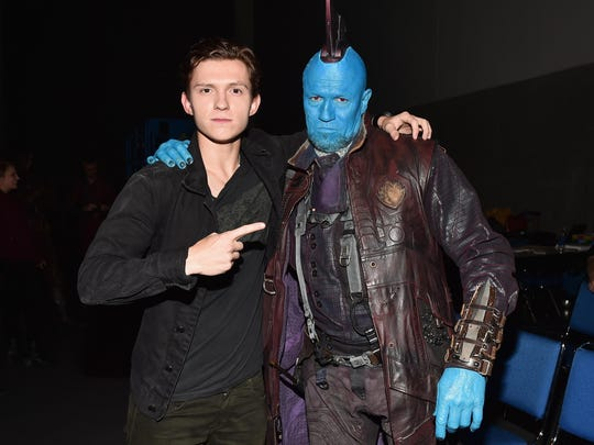 """Actors Tom Holland from Marvel Studios """"Spider-Man: Homecoming (L) and Yondu (Michael Rooker) from Marvel Studios' """"Guardians Of The Galaxy Vol. 2"""" attend the San Diego Comic-Con International 2016 Marvel Panel."""
