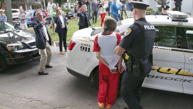Holly Colino is taken back to jail after being arraigned in Brockport Village Court, for the murder of Megan Dix, Tuesday, Aug. 29, 2017.