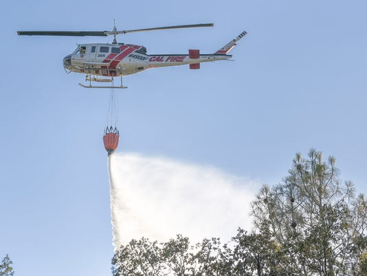 636339467491420391-CDF-Helicopter-205-drops-water-on-hot-spots.jpg