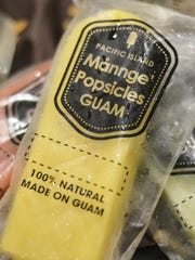 "A ""Ripe Mango"" Mannge' Pop sits atop other locally-sourced popsicles made from all-natural ingredients."
