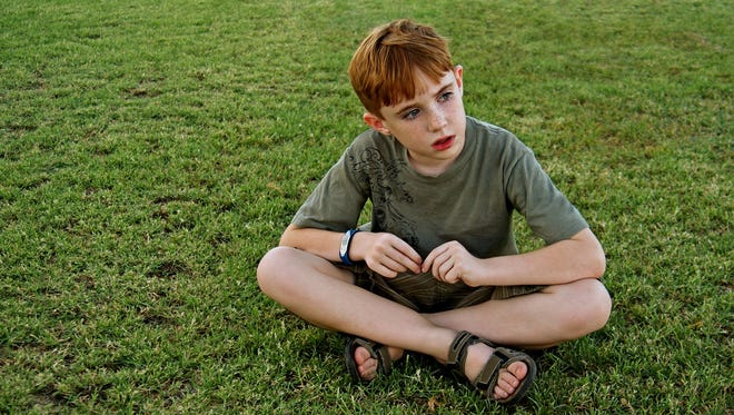 The number of children diagnosed with autism will likely decline in the coming years, according to researchers who have reassessed population data and found a slight drop in prevalence based on new diagnostic criteria.  Getty Images/Hemera Boy sitting on grass, Photo by Nancy Price Getty Images/Hemera