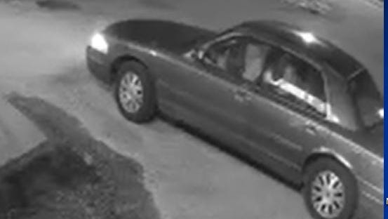 This burgundy Ford Crown Victoria was captured on surveillance footage outside the Pantry 1. Police said the driver got out and threw a rock through the store's front door.