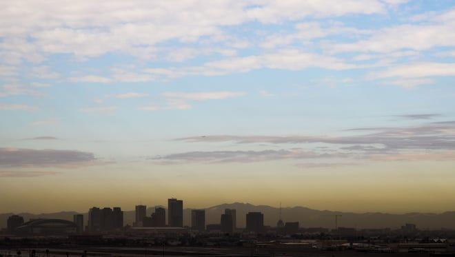 Brown haze hangs over the downtown Phoenix skyline Dec. 5, 2017.