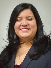 Melissa Lopez, executive director of the Diocesan Migrant & Refugee Services.