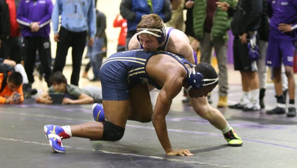 New Rochelle's Jake Logan wrestles Taha Huggins from Putnam Vocational (MA) in a 182-pound match of the Shoreline Classic wrestling tournament at New Rochelle High School in New Rochelle on Saturday, January 6, 2018.