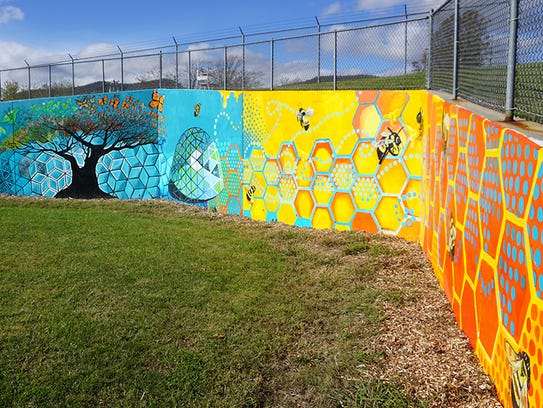 The Owen Middle School mural is the work of more than