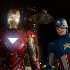 """Iron Man, portrayed by Robert Downey Jr. (left) and Captain America, portrayed by Chris Evans, are shown in a scene from """"The Avengers."""""""