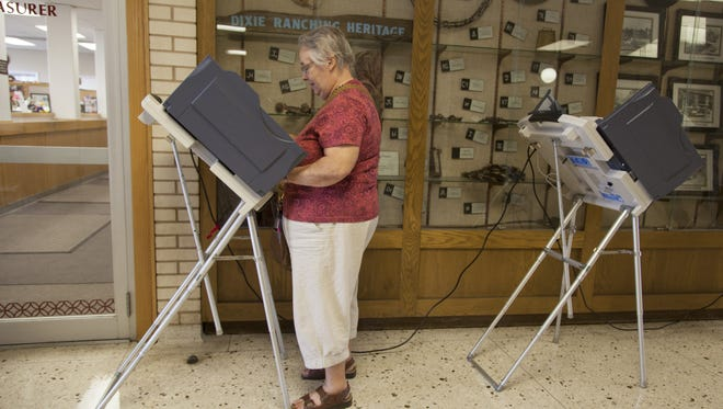 St. George resident Rachel Parkinson votes at the Washington County Administration Building Tuesday, Aug. 11, 2015.