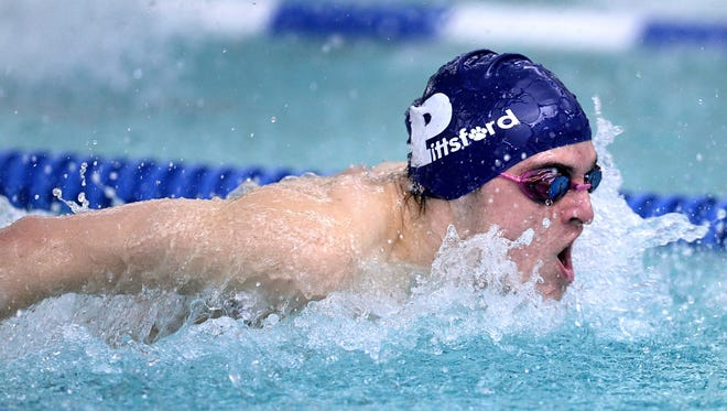 Pittsford's Casey Ransford wins the 100 butterfly with a time of 55.14.