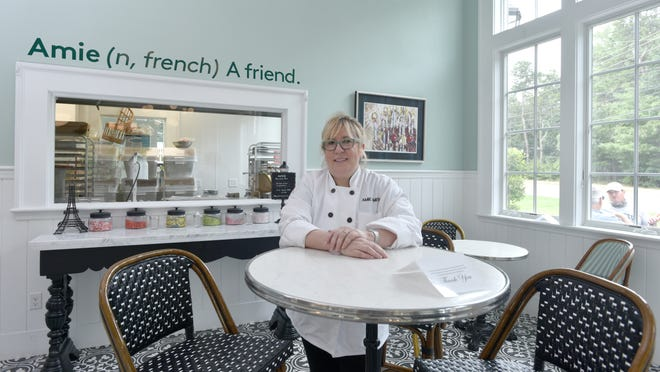 "AMIE owner Amie Smith takes a moment to chat at her Osterville bakery. ""At the end of the day, a bakery is a happy place and now more than ever people need to have something to look forward to  - even if it's as simple as taking a quick ride to get a cookie and a latte,"" she says."