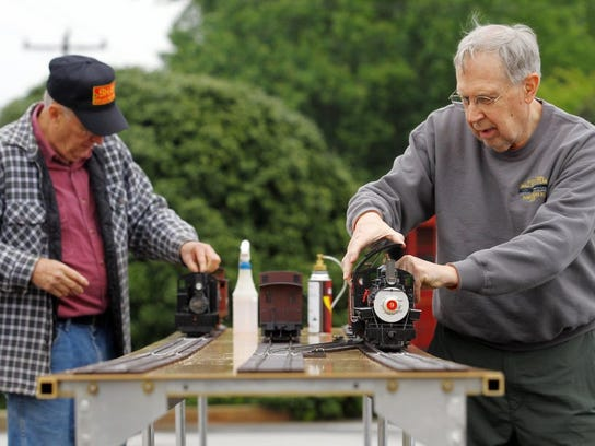 Charles Mote, right, and Bruce Gathman operate steam