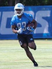 Lions receiver Dontez Ford catches passes during practice Monday, July 31, 2017, at the practice facility in Allen Park.