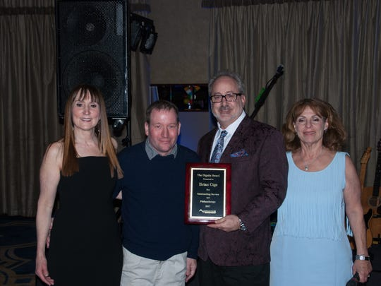 Brian Cige, Esq., was presented with the Dignity Award