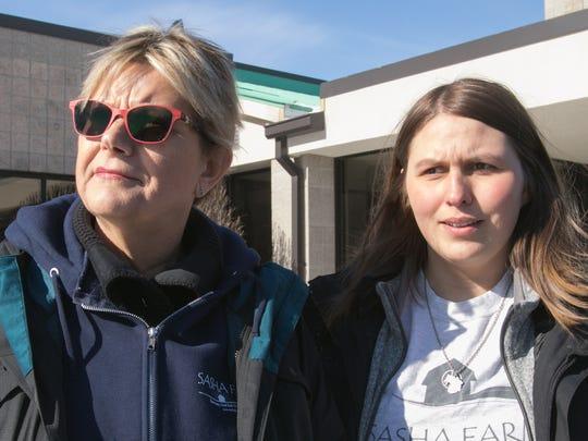 SASHA Farm director/founder Dorothy Davies, left, listens