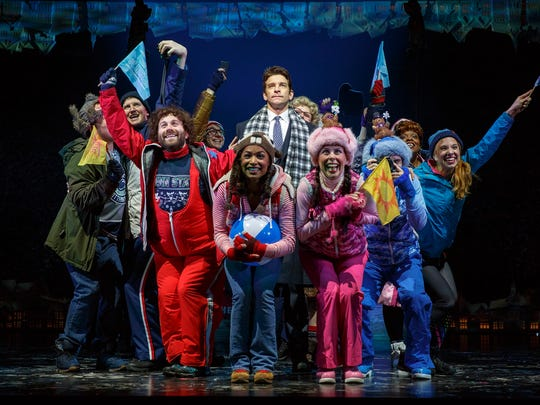 Andy Karl (center) stars as Phil Connors in 'Groundhog
