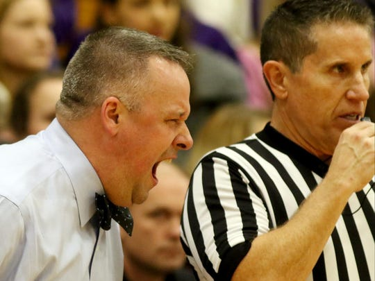 St. Xavier head coach Jimmy Lallathin reacts to a referees