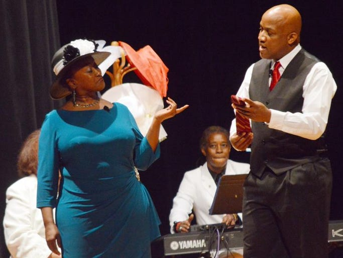 """ANI Juneteenth play Crowns Karen Riley Simmons (left) and Bruce Cotton perform a scene in the City Park Players and Central Louisiana Juneteenth Association's production of """"Crowns"""" held Sunday, June 15, 2014 at Peabody Magnet High School. """"Crowns"""" is the story of African-American women and the hats they wear. Starring in the production in addition to Simmons and Cotton are Sylvia Davis, Rosa Ashby Metoyer, Anne Angelle, Andrea Martin, Marilyn Long, Zelba Baines, Rodessa Metoyer, Kenyada Smith, Numa Metoyer and Shayla Simmons.  The play was presented free to the public as part of the Juneteenth celebration. Juneteenth marks the end of slavery in the U.S. when Union troops landed in Texas and informed residents that the Civil War had ended and slaves were free."""