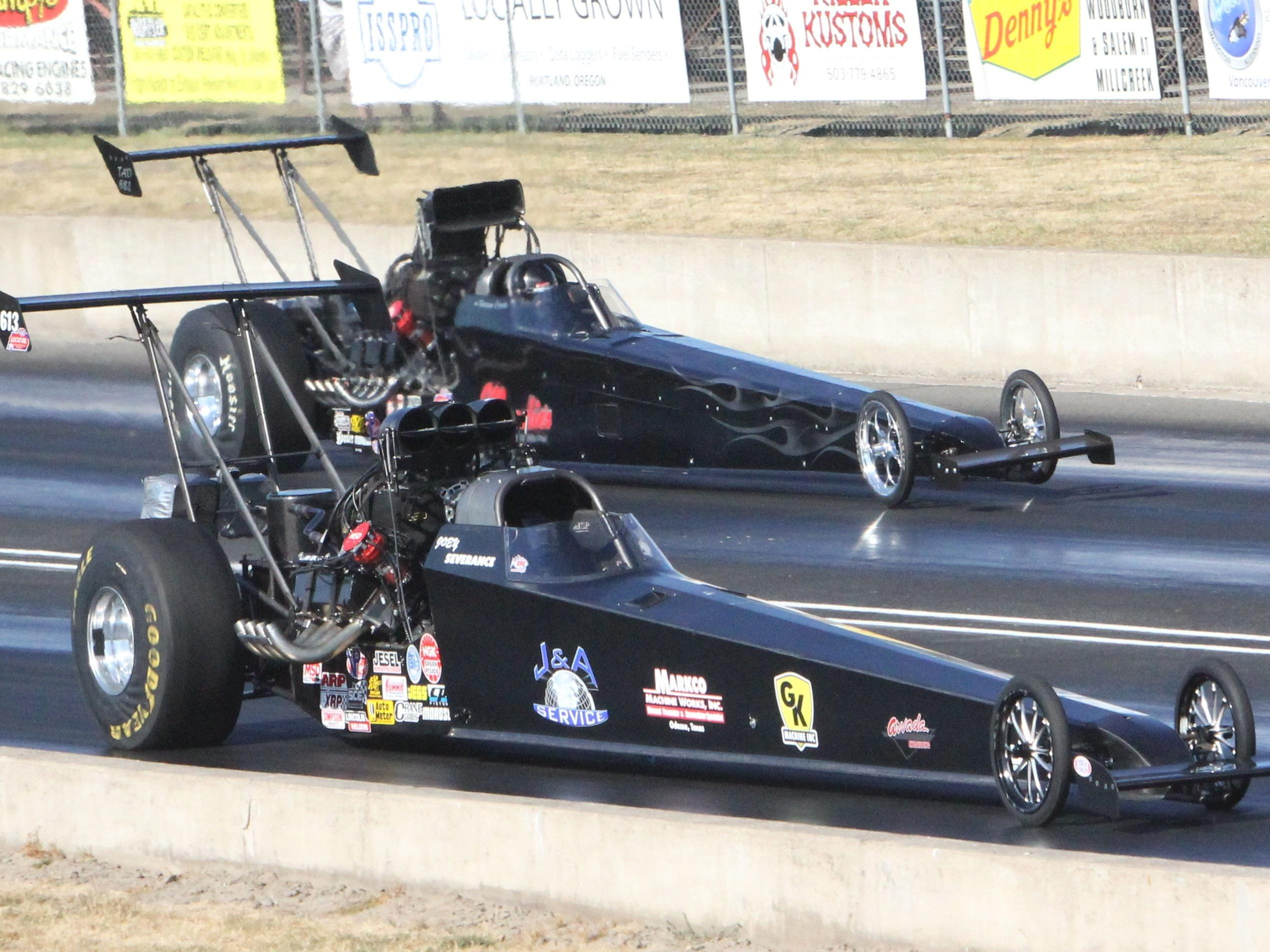 Joey Severance (near lane) leads Shawn Cowie at Woodburn Dragstrip on his way to winning the Top Alcohol Dragster category at the Les Schwab Challenge on Sunday, July 19, 2015.