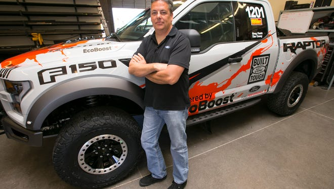 Greg Foutz, owner and founder of Foutz Motorsports, is seen with the Ford F-150 Raptor, at Foutz Motorsports in Mesa on Tuesday, May 10, 2016. Foutz is responsible for building the highly-anticipated return of the Ford F-150 Raptor in 2017 and races this truck.