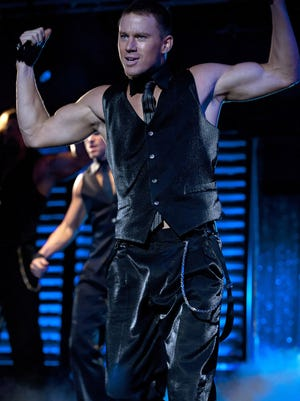 "Channing Tatum flexes his dance muscles as Mike in the motion picture ""Magic Mike."" He says a musical of the movie is still in progress."