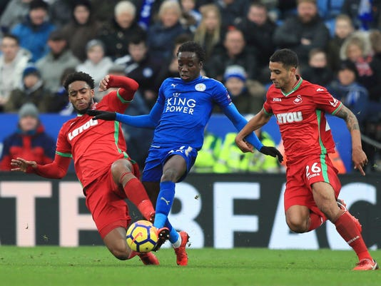 Swansea City's Leroy Fer, left, and teammate Martin Olsson battle with Leicester City's Fousseni Diabate, centre during the English Premier League soccer match between Leicester City and Swansea City, at the King Power Stadium, in Leicester, England, Saturday, Feb. 3, 2018. (Simon Cooper/PA via AP)