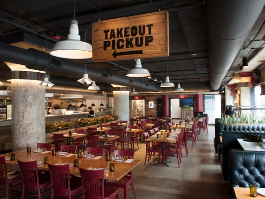 A take-out station is at the center of 24 Wood-Fired Fare, a Jose Garces property in Philadelphia.