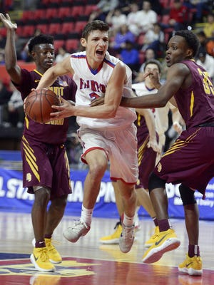 Fairport's Dan Masino, center, tries to split the defense of Mount Vernon's Demetre Roberts, left, and Jayquan Smith during the NYSPHSAA Boys Basketball Championships Class AA final in Binghamton on March 19, 2017. Fairport's season ended with a 59-48 loss to Mount Vernon-I in the state final.