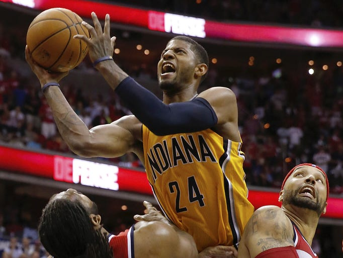 Indiana Pacers forward Paul George (24) shoots between Washington Wizards forward Nene from Brazil (42) and Washington Wizards forward Drew Gooden during the second half of Game 4 of an Eastern Conference semifinal in Washington, Sunday, May 11, 2014. The Pacers won 95-92.