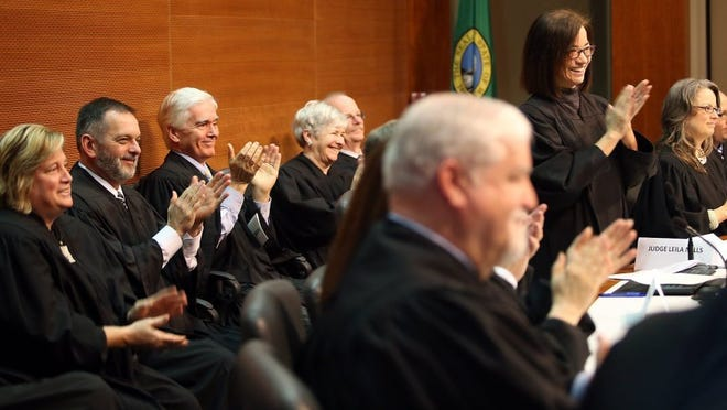 Judges from the Kitsap and Mason county benches applaud after Judge Jeffrey Bassett was sworn in Friday in Port Orchard.