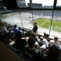 Fans walk through the players tunnel during a Lambeau Field stadium tour on July 21.