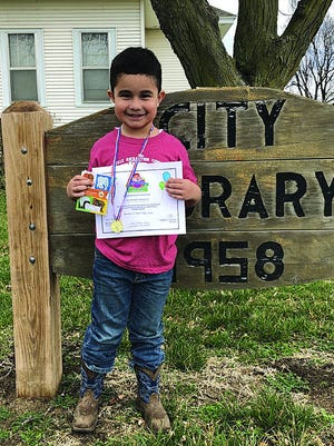 Juan Villanueva Jr. recently earned a special recognition for reading 1,000 books at the Macksville City Library. In January 2020 his father, Juan Francisco Villanueva Holguin, earned his American citizenship status with a special ceremony in Wichita, which he pursued in order to give his son better opportunities.