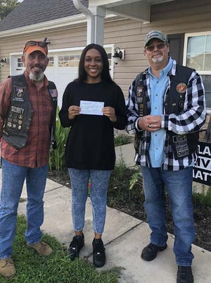 Rolling Thunder Chapter NC-5 recently awarded Antonia Foremen of Holly Ridge the SSgt Anthony L. Goodwin Memorial Scholarship. She is a graduate of Dixon High School and will be attending the Fashion Institute of Technology in New York. Presenting the scholarship check are NC-5 members Joe Fore and Ray Howe.