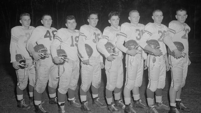 Members of the 1958 Barnstable High School football squad.