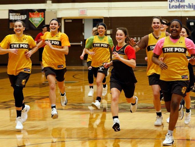 Members of the Kickapoo girls basketball team run to
