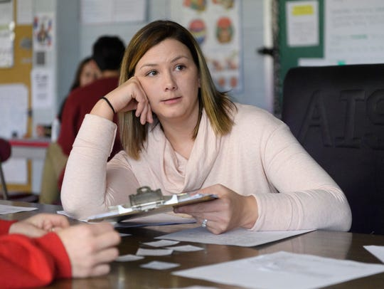 Jenna Conner listens to a question from a student during