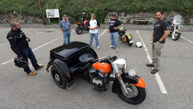 Mike 'The Junkman' Anest, c,  of Boonton talks to fellow bikers about his 1971 Harley Davidson service car during the monthly themed 'First Friday' Biker Night event in downtown Boonton. August 5, 2016, Boonton, NJ