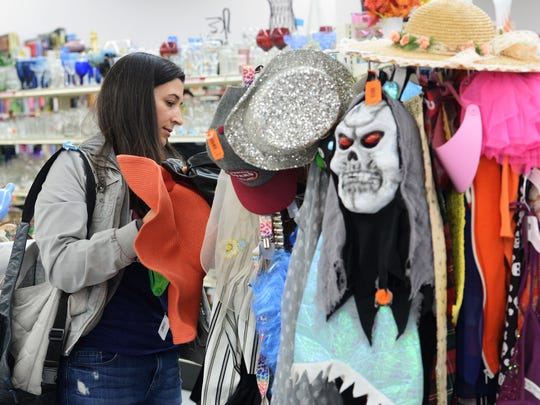 Whitney Weber shops for a costume for the Zombie Crawl at arc Thrift Store on Friday in Fort Collins.