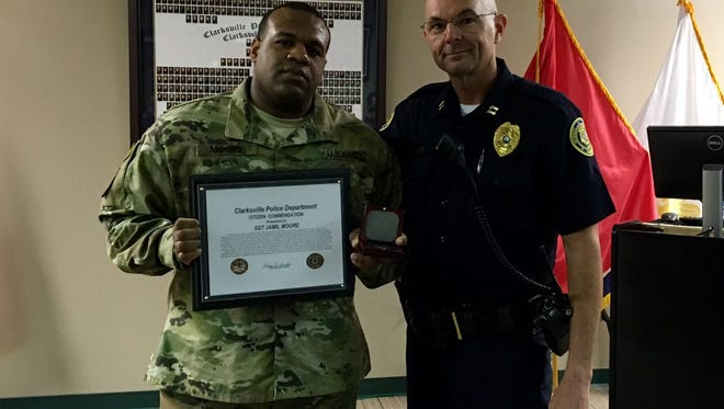 Capt David Crockarell, presented Sgt. Jamil Moore with a Citizen Commendation Certificate and a CPD coin.