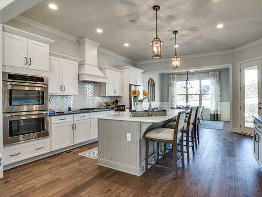 The kitchen from a Riverbluff home features high-end finishes.
