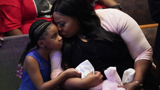 Roxie Washington holds Gianna Floyd, the daughter of George Floyd, as they attend Floyd's funeral service June 9 at The Fountain of Praise Church.