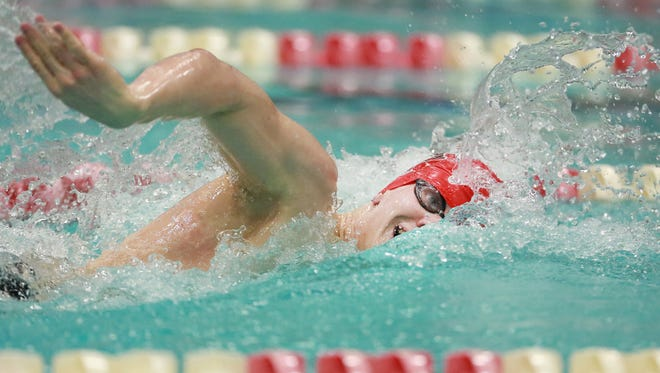 Waukesha South/Catholic Memorial's John Acevedo swims the 500 freestyle during the WIAA Division 1 state boys swim meet at the UW Natorium last February.  He won the event with a time 4:30.12.  Joe Koshollek/For the Milwaukee Journal Sentinel