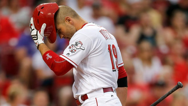Reds first baseman Joey Votto wipes his brow between pitches during an April 19 game.